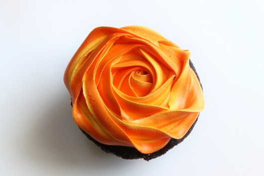 two tone frosting on a rose cupcake orange and yellow frosting 530x353