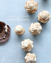 Banana Cupcakes with Bourbon Butterscotch Filling and Toasted Marshmallow Frosting from Bakers Royale 210x260