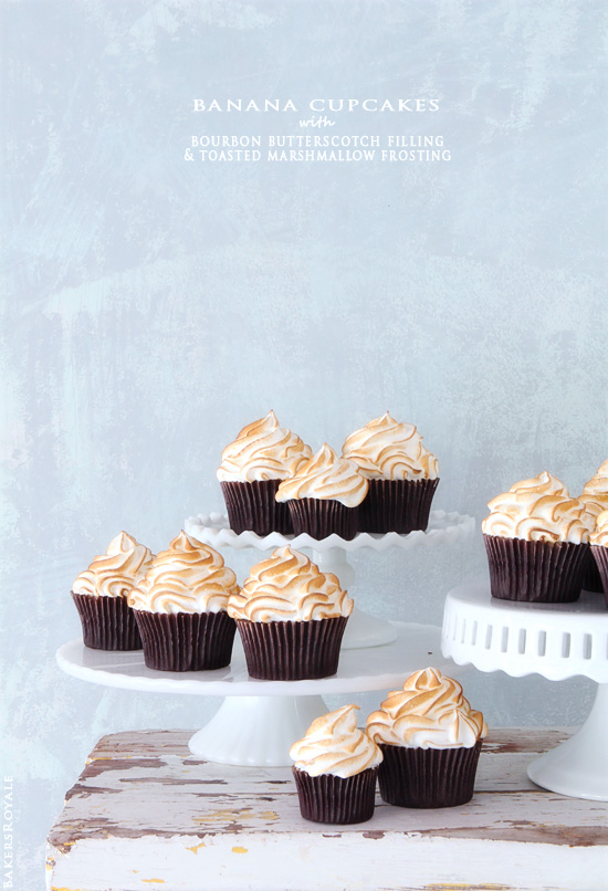 Banana Cupcakes with Bourbon Butterscotch Filling and Toasted Marshmallow Frosting via Bakers Royale