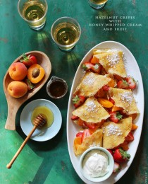 Hazelnut Crepes with Honey Whipped Cream and Fruit via BakersRoyale 210x260