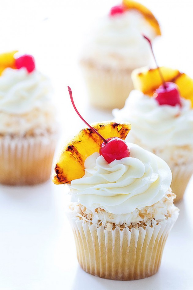know, pina colada cupcakes are everywhere, but these are rum soaked ...
