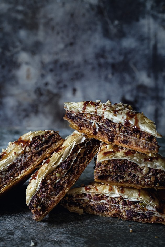 Five pieces of chocolate baklava stacked together.