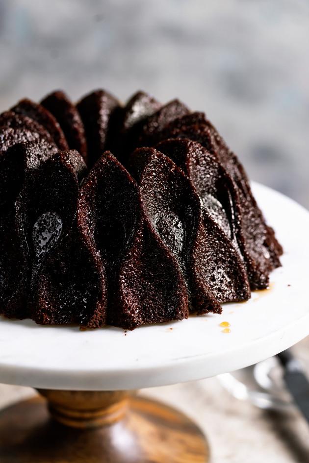 Chocolate rum cake on a cake stand.