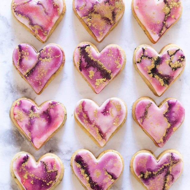 Hand Painted Watercolor Marble Cookies made with a no-spread sugar cookie base  and marshmallow fondant for the canvas. - I know everyone is all about the super bowl right now, me I'm all about the hearts! Head to the blog for the full recipe and details. - #cookies #decoratedcookies #paintedcookies #fondant